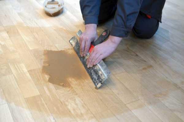 Щели в ламинате на полу: чем замазать между планками, как убрать после укладки