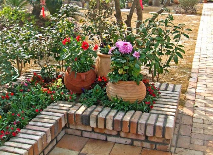 Оформление цветников на даче своими руками фото из подручных средств фото 693